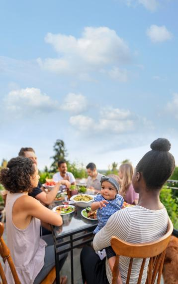 Diverse family gathering around an outdoor table