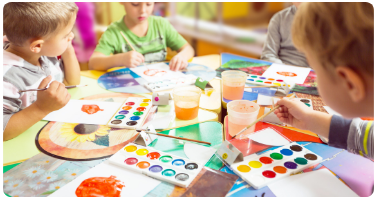 Children at a daycare, participating in a painting activity