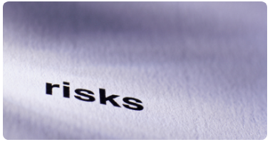 "A printed paper with the word ""risks"" on it"